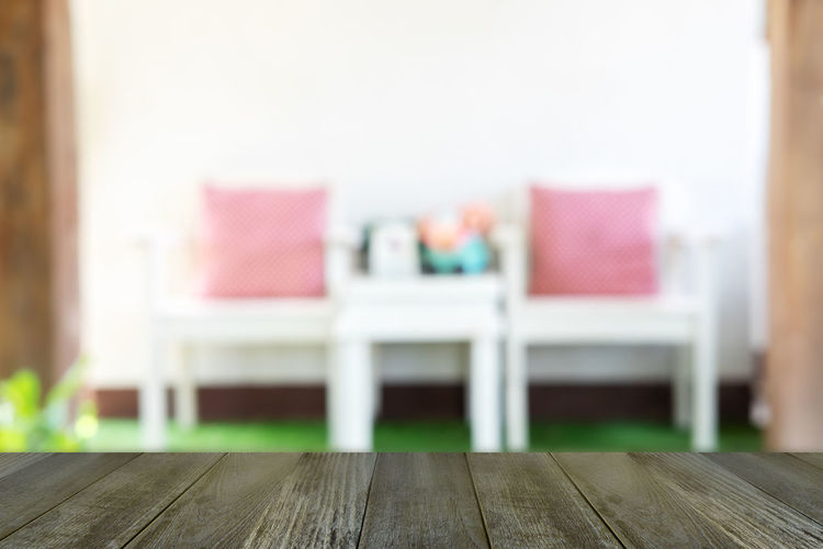 Close-up of empty chairs on table