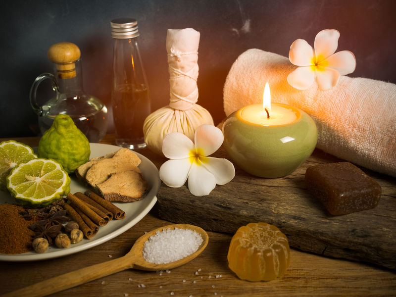 Spa massage items,aroma oil,herbal compress ball,soap,salt scrub and towel in candlelight. Herb Light Relaxing Alternative Medicine Alternative Therapy Beauty Spa Bergamot Candle Candlelight Compress Bal Cream Flower Massage Nature Oil Organic Scrub Skincare Soap Spa Treatment Towel Treatment Wax