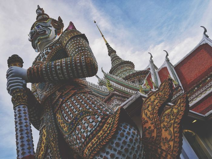 Wat Arun giant Giant Buddhism Place Of Worship Sky Low Angle View Religion Belief Spirituality Art And Craft Day Statue Craft