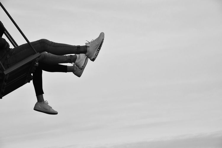 Kick it! Outdoors From My Point Of View EyeEm Best Shots Lookingup Human Body Part The Human Condition Flying Swinging Legs Swing Blackandwhite Eye4photography  EyeEm Gallery Malephotographerofthemonth EyeEm Capture The Moment Adrenaline Togetherness Having Fun Shoes Low Section Sitting Sky