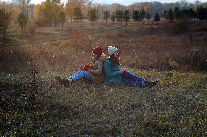 Low section of women relaxing on grass