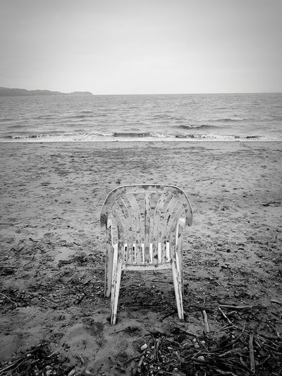 Lonley Chair On Sand Beauty In Nature Beachphotography Sand Sea No People Sky Outdoors Day Water Landscape