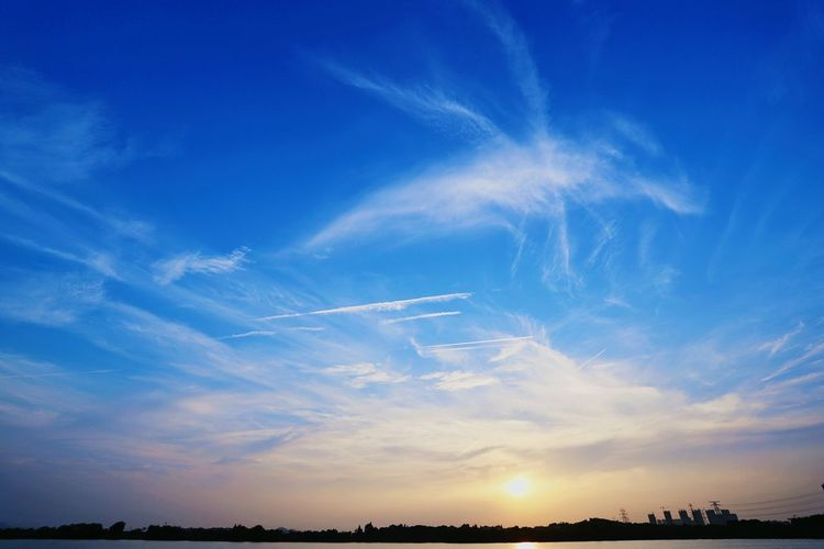 Low Angle View Of Silhouette Landscape Against Blue Sky During Sunset