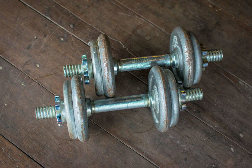 Metal dumbell on wood floor background Body & Fitness BodyBuilder Bodybuilding Exercise Iron Wood Aluminium Backdrop Background Close-up Color Colour Day Dumbbell Exercising Fit Fitness Floor Gym Hardwood Floor Health Health Club Healthy High Angle View In Door Indoors  Kilo Metal No People Old Wood Sport Wood - Material