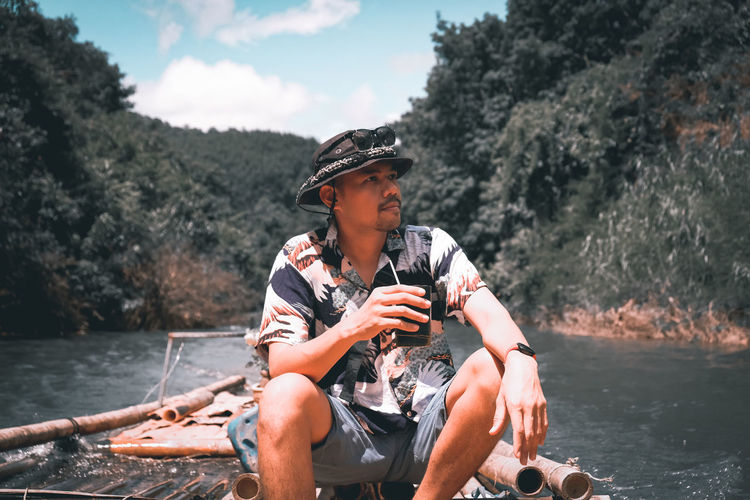 Young man looking at river