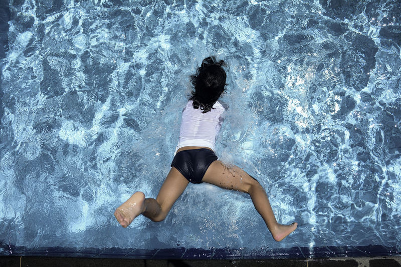 High angle view of woman diving in swimming pool