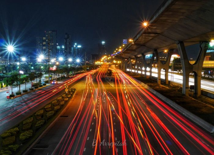 High angle view of light trails on city at night