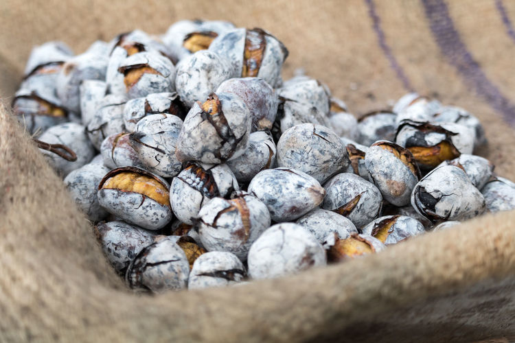 High Angle View Of Roasted Chestnuts On Sack