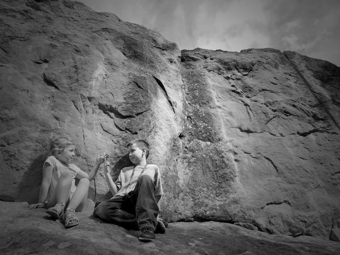 Kids at the Park Children Kids Youth Fun Play Brother & Sister Bnw Blackandwhite Siblings Sky Rock Rock - Object Nature Solid Day Real People Mountain Rock Formation Lifestyles Land Non-urban Scene Leisure Activity Outdoors