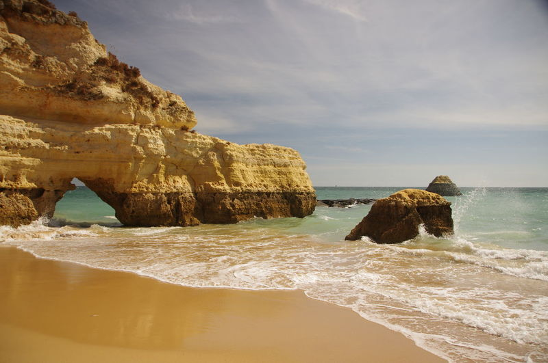 Cliffs and natural arch in Algarve, Portugal Arch Awe Beach Beauty In Nature Bedding Cliffs Coastline Day EyeEmNewHere Geology Landscape Natural Arch Natural Bridge  Nature No People Outdoors Portugal Rock - Object Rock Arch Sand Scenics Sea Travel Travel Destinations Vacations