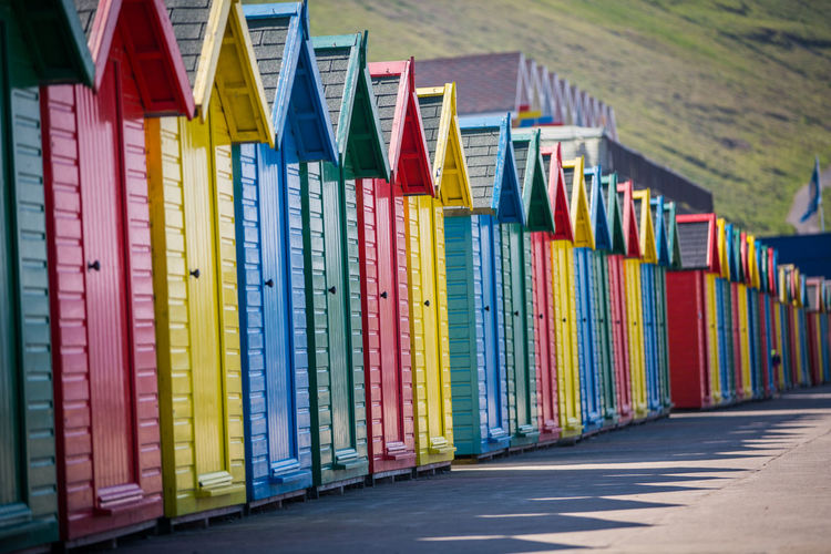 Beach huts Whitby Yorkshire Architecture Arrangement Beach Chalet Beach Hut Beach Huts Building Building Exterior Built Structure Choice Close-up Day Decoration Hut In A Row Large Group Of Objects Multi Colored No People Order Outdoors Side By Side Variation