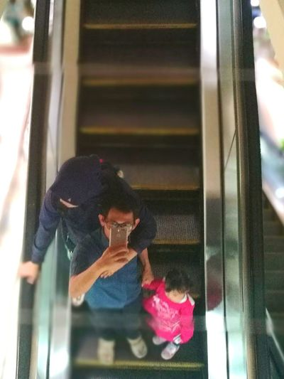Walking down the elevator. Holding hands together. This is LOVE! Family❤ FamilyTime Family Love  Escalator Escalator Mirror Reflection Togethernessishappiness Tourismindonesia Mallofasia Gajahmada P9plus Huawei Huawei P9 Plus Leica Huawei P9 IndoorPhotography