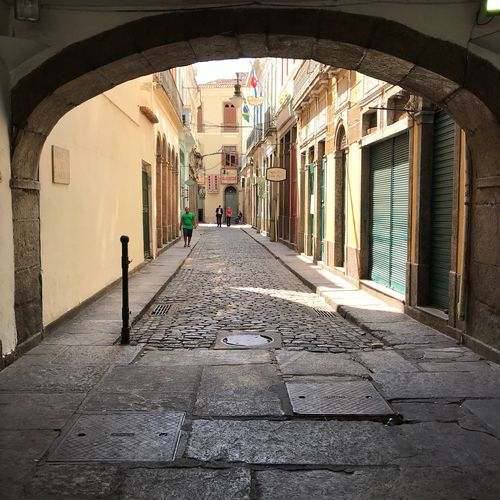 EyeEmNewHere Architecture Arch Built Structure Real People The Way Forward Walking Building Exterior Men Day One Person City Outdoors People