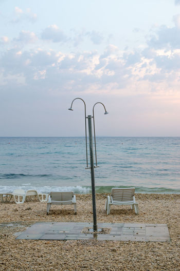 The sun was setting behind the clouds, when I ran across that beach shower somewhere on the island of Pag, Croatia near Novalja. Bathing Beach Beach Chairs Beach Lounger Beach Shower Clean Clear Sky Clouds Horizon Over Water Loungers No People Ocean Ocean View Outdoors Pebble Stones Pebbles Sea Shower Shower Time Sunset Tranquility View Washing Water Waterfront