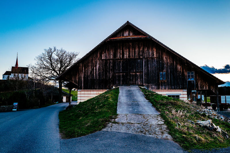 Architecture Blue Building Exterior Built Structure Clear Sky Diminishing Perspective Empty Gormund Grass House Kapelle Long Outdoors Pathway Road Sky Street The Way Forward Transportation Tree Vanishing Point Walkway