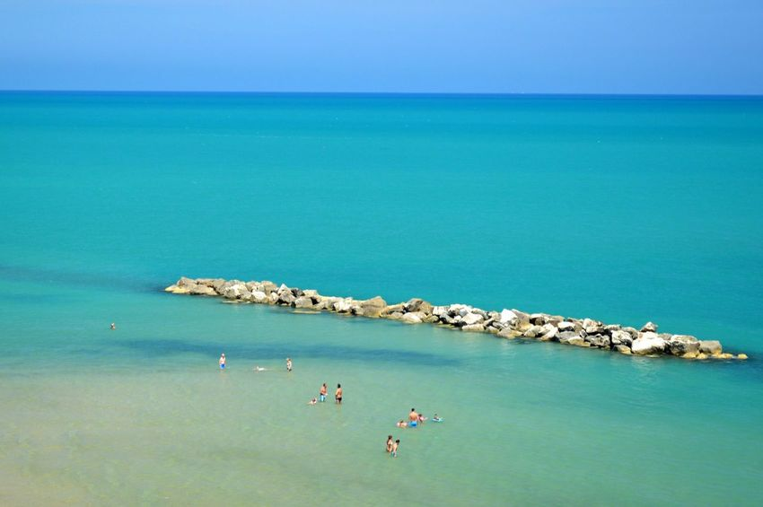 Beach Beauty In Nature Blue Clear Sky Enjoyment High Angle View Horizon Over Water Idyllic Large Group Of People Nature Non-urban Scene Scenics Sea Seascape Shore Summer Swimming Tourism Tourist Tranquil Scene Tranquility Travel Destinations Vacations Water Weekend Activities