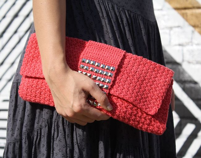 Close-up of woman holding a clutch