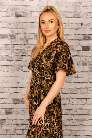 Studio portrait of a young woman in a leopard print dress Model Model Pose Modelgirl Young Adult Portrait Looking At Camera Beauty Young Women Beautiful Woman Women Long Hair Fashion Blond Hair Blonde Girl Blonde Leopard Print Dress Ponytail Studio Shot Studio Photography Studio Portrait Studiophotography