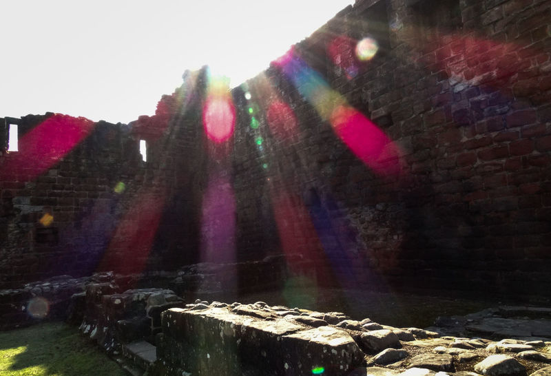 Architecture Brick Wall Building Building Exterior Built Structure Castle Castle Ruin Castle Walls City Day Falling Lens Flare No People Outdoors Penrith Season  Sky Street Sun Sunbeam Sunlight Wall - Building Feature Water Wet