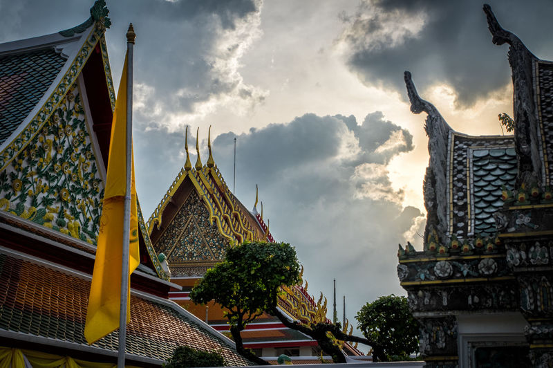 Buddhist temple in thailand Buddha Buddhist Temple Thailand Architecture Built Structure Religion Cloud - Sky Sky Belief Place Of Worship Spirituality Building Building Exterior No People Nature History Travel Destinations The Past Day Low Angle View Outdoors Spire  Ornate