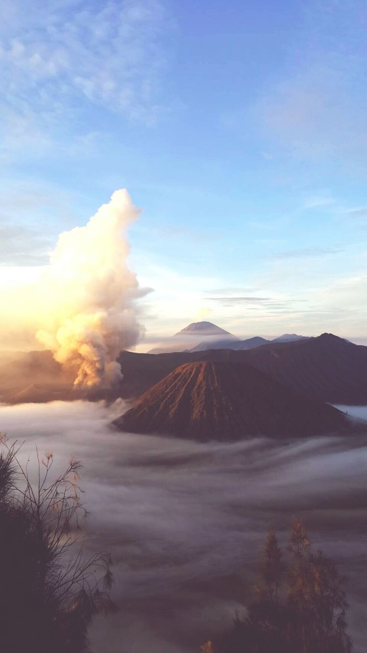 nature, beauty in nature, scenics, volcano, sky, tranquil scene, smoke - physical structure, mountain, outdoors, tranquility, cloud - sky, volcanic landscape, no people, physical geography, travel destinations, landscape, erupting, day, power in nature