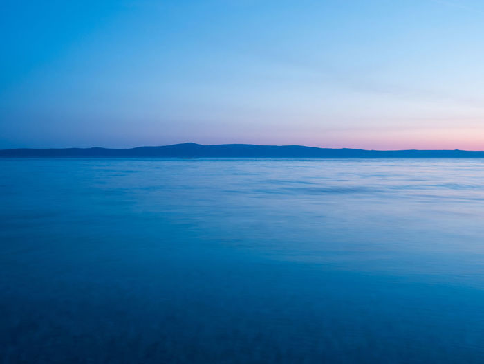 Calm blue sea landscape with island at background at sunset Adriatic Sea Beauty In Nature Blue Calm Clear Sky Croatia Holiday Horizon Over Water Idyllic Island Landscape Long Exposure Mediterranean  Nature No People Nobody Outdoors Scenics Sea Sky Sunset Tranquil Scene Tranquility Travel Water