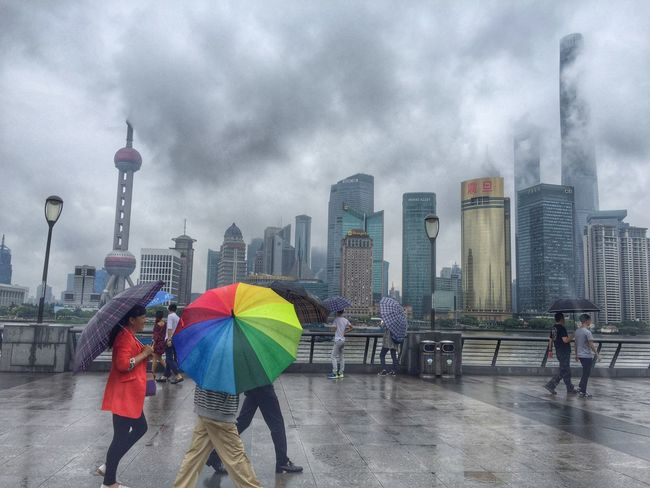 Architecture City Built Structure Colors And Patterns Skyscraper Tower Men Person Walking Rain Sky City Life Urban Skyline Umbrella Color Pattern Shanghai Pudong China Wanderlust Foggy Smog Pollution