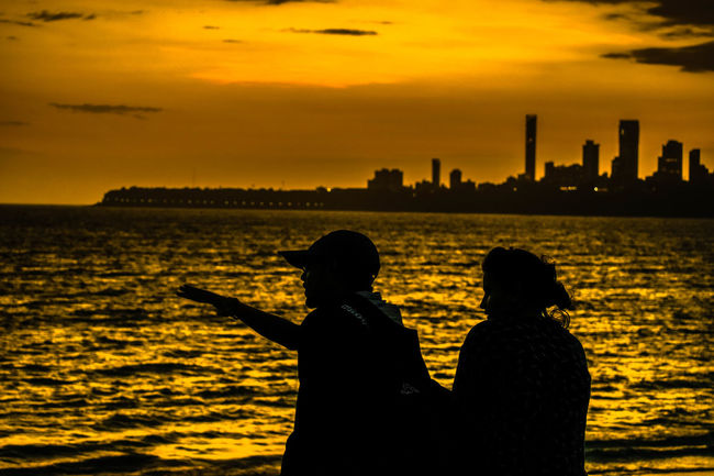 DailymumbaiMumbaicityRealpeopleAdapted To The City Cityscape People Real People Sea Silhouette EyeEm Best Shots EyeEm Gallery Eye Paint The Town Yellow
