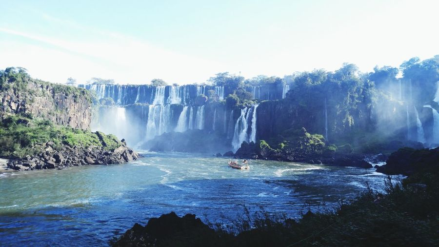 Scenic view of iguacu falls against sky