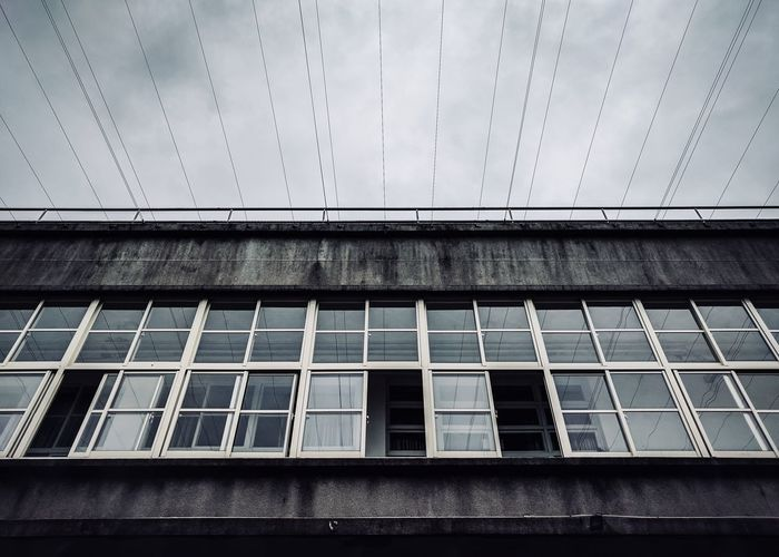 Moody weather Outdoors Close-up Built Structure Sky Day Window Building Exterior No People Architecture Steel Windows Lookup Architecture Photography Architecture Building Building And Sky Buildings Architecture Nexus6P Textured  Rough Wires In The Sky Wires And Sky Wires Up The Sky Structures And Architecture Structures & Lines