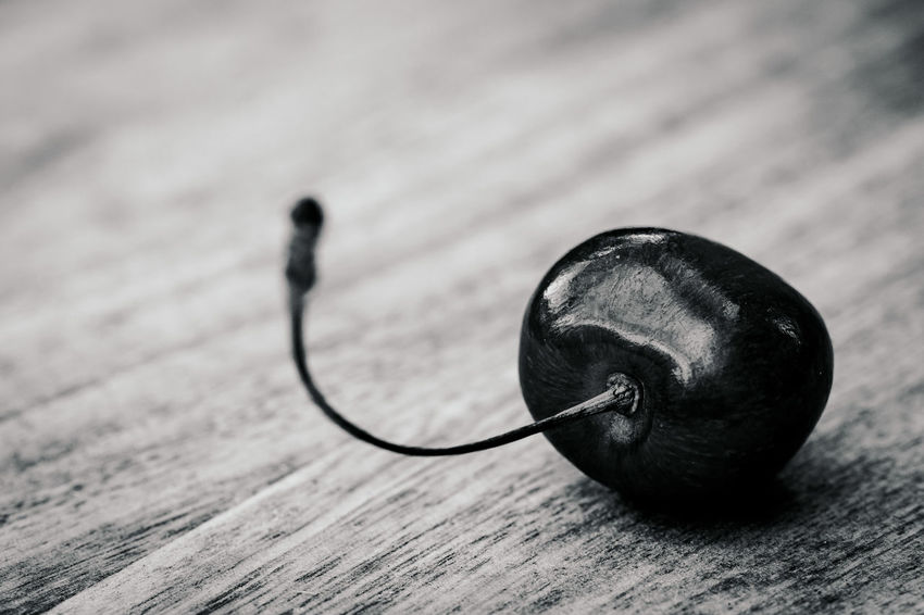 Some Cherries Arts Culture And Entertainment Close-up Creativity Day Focus On Foreground High Angle View Indoors  Listening Metal Music Musical Equipment Musical Instrument No People Selective Focus Shape Single Object Still Life Table Two Objects Wood - Material