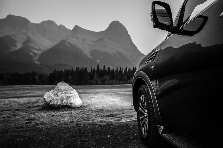 near dusk, looking for wild elks Headlights Nissan V8 Blackandwhite Monochrome Hill Mountain Range Rocky Mountains Country Mountain Adventure Journey Forest Pinaceae Mountain Range Sky Travel Countryside Vehicle
