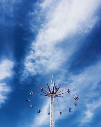 Amusement Park Low Angle View Arts Culture And Entertainment Amusement Park Ride Sky Cloud - Sky Day Blue Enjoyment Leisure Activity Outdoors No People Carousel Travel Destinations Ireland Vacations Travel People OceanCity Fun EyeEm Selects