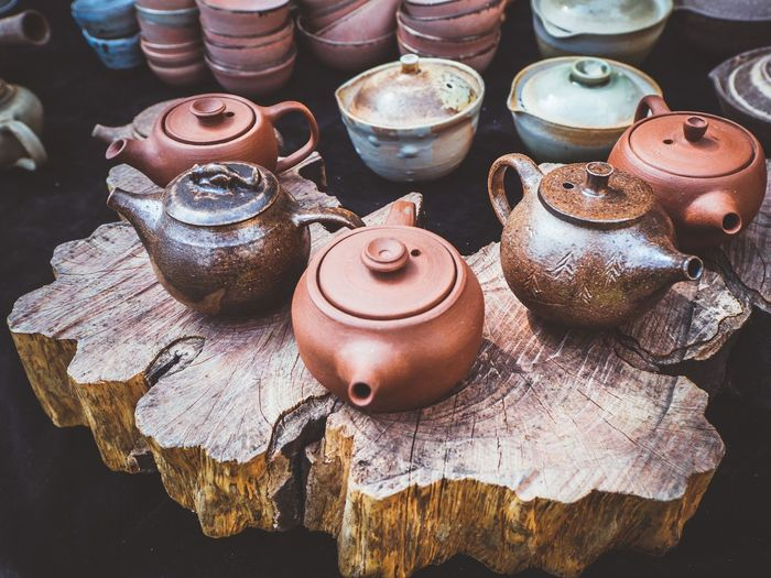 Teapot collection Table EyeEmNewHere uniqueness Tea Tea Cup Chinese Culture Tea Time Vintage Teapot Hand Craft Still Life High Angle View Art And Craft Craft No People Pottery Container Indoors  Earthenware Large Group Of Objects Table Pot Ceramics Metal Day Group Of Objects Brown Creativity Small Business Choice