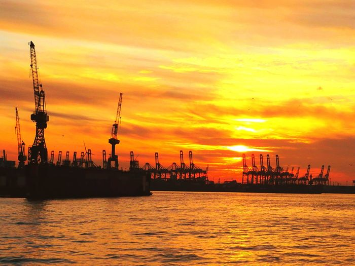 Nature Beautiful Sunset Sundown, Nightfall, Close Of Day, Twilight, Dusk, Evening Orange Sunset Focus On Foreground River Elbe Hourbour Town Seaport District Beauty In Nature Sunlight Sunshine ☀ Day Outdoors Crane - Construction Machinery Cranes Of Hamburg Crane - Construction Machinery Cranes For Construction Multi Colored Sunset Silhouettes Sunset Photography Industry Water Sunset Sea Silhouette Business Finance And Industry Sky Drilling Rig Drill Nautical Vessel Commercial Dock
