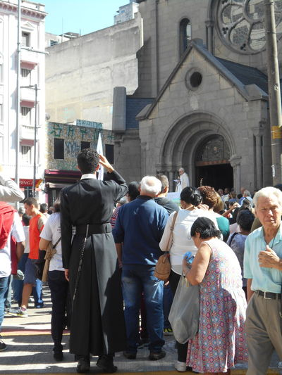 """Man of Faith participates in the Corpus Christi outdoor Mass and demonstration """"Pastoral do Povo da Rua"""" held at the Santa Ifigênia church in downtown São Paulo on May 31, 2018. In Brazil, Corpus Christi is a Catholic celebration commemorating the Eucharist (the Eucharist is the symbolic presence of the Body of Christ in the consecrated host). The Corpus Christi holiday does not happen on the same day every year. Corpus Christi Corpus Christi Holiday Igreja De Santa Ifigênia May 31 May 31, 2018 Santa Ifigenia Viaduct Susan A. Case Sabir Unretouched Photography Belief Catholic Faith Catholic Religion Downtown São Paulo Man Of Faith Outdoor Mass Outdoor Congregation Real People Reinforcement Religious Holiday Santa Ifigenia Solidarity Street Photography Sunny Day Togetheness Urban Photography"""