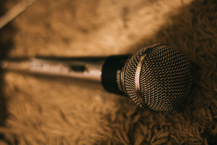 Close-up of microphone on rug