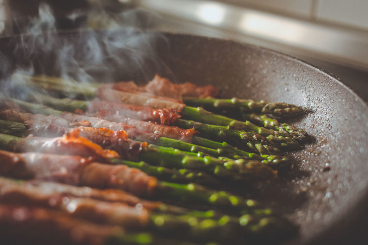 Close-Up Of Asparagus And Meat In Cooking Utensil At Home