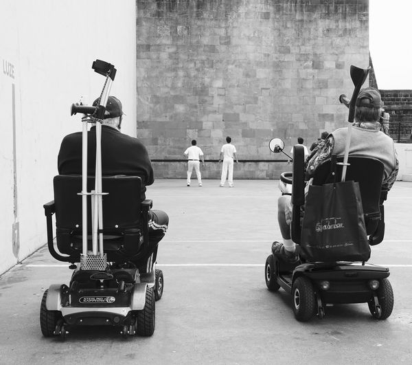 Rear view of men sitting in wheelchairs