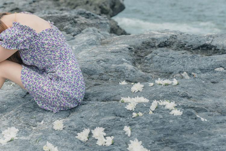 Side view of woman walking on rocks