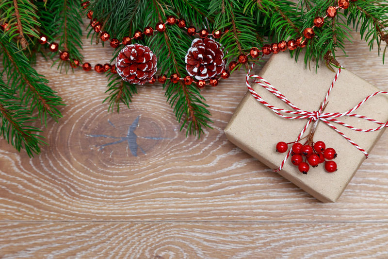Christmas gift Christmas Time Celebration New Year Christmas MAS Xmas Gift Box Gift Box Rope Wrap Tradition Present Suprise Above Preparation  Christmas Tree Overhead View Wooden Background Flat Lay Branch Rustic Spruce Free Space Free Background