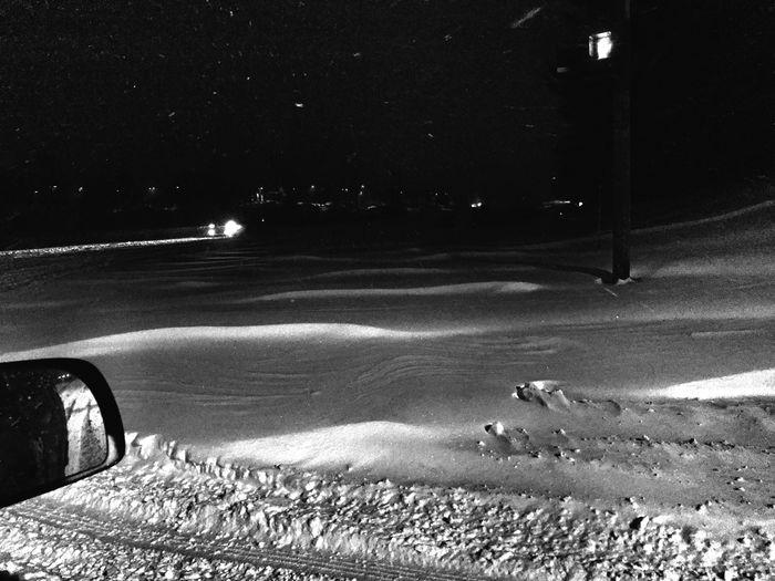 View of illuminated road at night