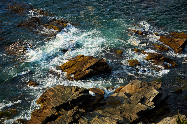 Ocean at sunset... Beach Day High Angle View Aquatic Sport Outdoors Rocky Coastline Rock Formation Land Sport Nature Wave Water Motion Beauty In Nature Rock Rock - Object Solid Sea No People Breaking Scenics Waves Seascape Aerial View Sunset