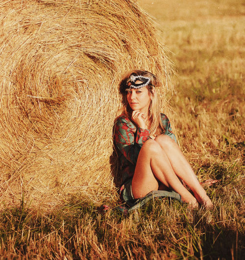 Adult Agriculture Bale  Beautiful Woman Beauty Blond Hair Day Field Grass Hay Haystack Landscape Leisure Activity Nature One Person One Woman Only One Young Woman Only Only Women Outdoors Portrait Rural Scene Sitting Summer Young Adult Young Women