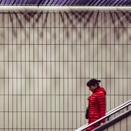 City Life Descending Errands Going Down Motion Blur Stairway Transportation Traveling Day Downstairs Escalator Geometry Indoors  One Person People Real People Red Jacket Shadows Standing Straight Lines Subway Subway Station Symmetry Urban Young Adult