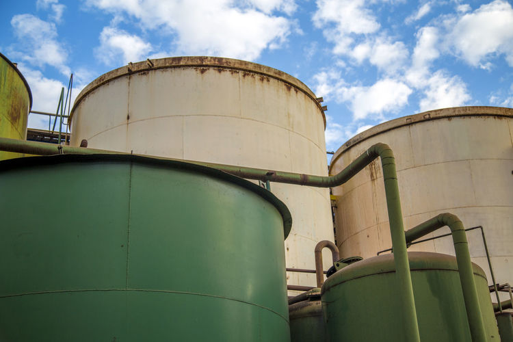 Destillery Alcohol Architecture Building Exterior Built Structure Cloud - Sky Day Factory Fuel And Power Generation Fuel Storage Tank Industrial Equipment Industry Low Angle View Metal Nature No People Oil Industry Outdoors Refinery Silo Sky Storage Compartment Storage Tank Sugar Cane Tank