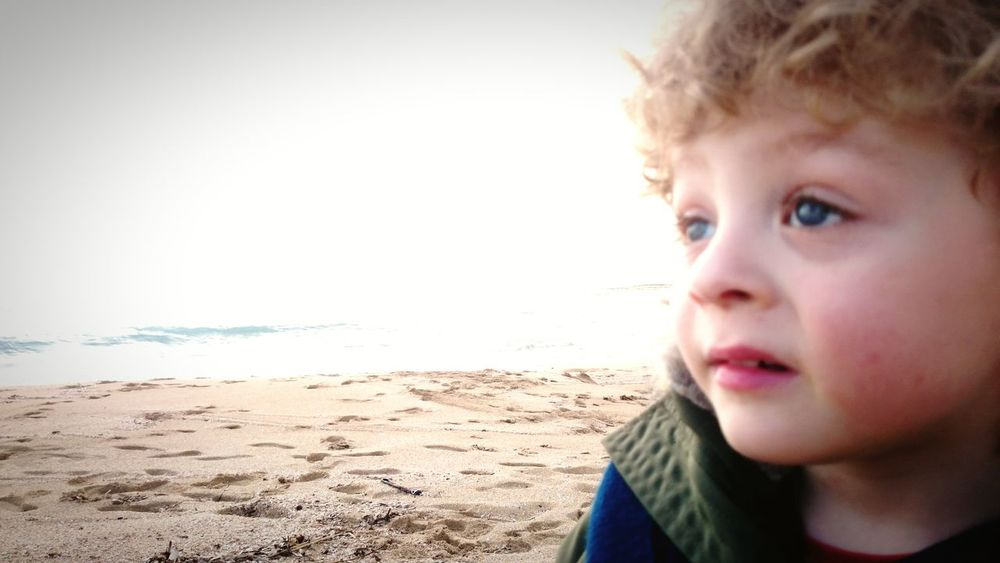 Beach Child Childhood Sea Headshot Children Only One Person Sand Day Dreaming People Boys Human Body Part Males  Outdoors Close-up One Boy Only Portrait Horizon Over Water Day Nature Future Thinking Second Acts Be. Ready.