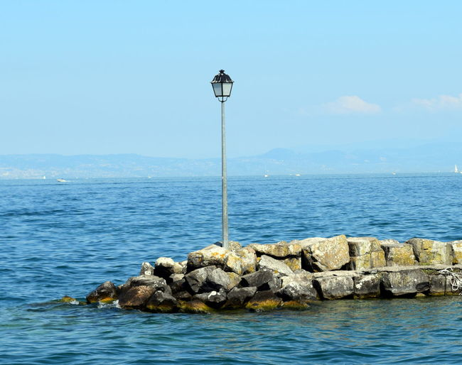 Blue Calm Horizon Over Water Lake Geneva Lamppost Outdoors Remote Sky Tranquil Scene Water