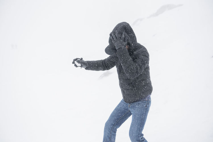Cold Temperature Day Full Length Leisure Activity Lifestyles One Person Outdoors People Real People Snow Standing Studio Shot Warm Clothing White Background Winter Young Adult Young Women