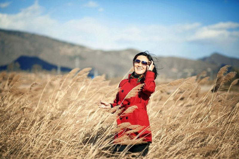 Smiling Woman Standing In Dry Pampas Grass Field